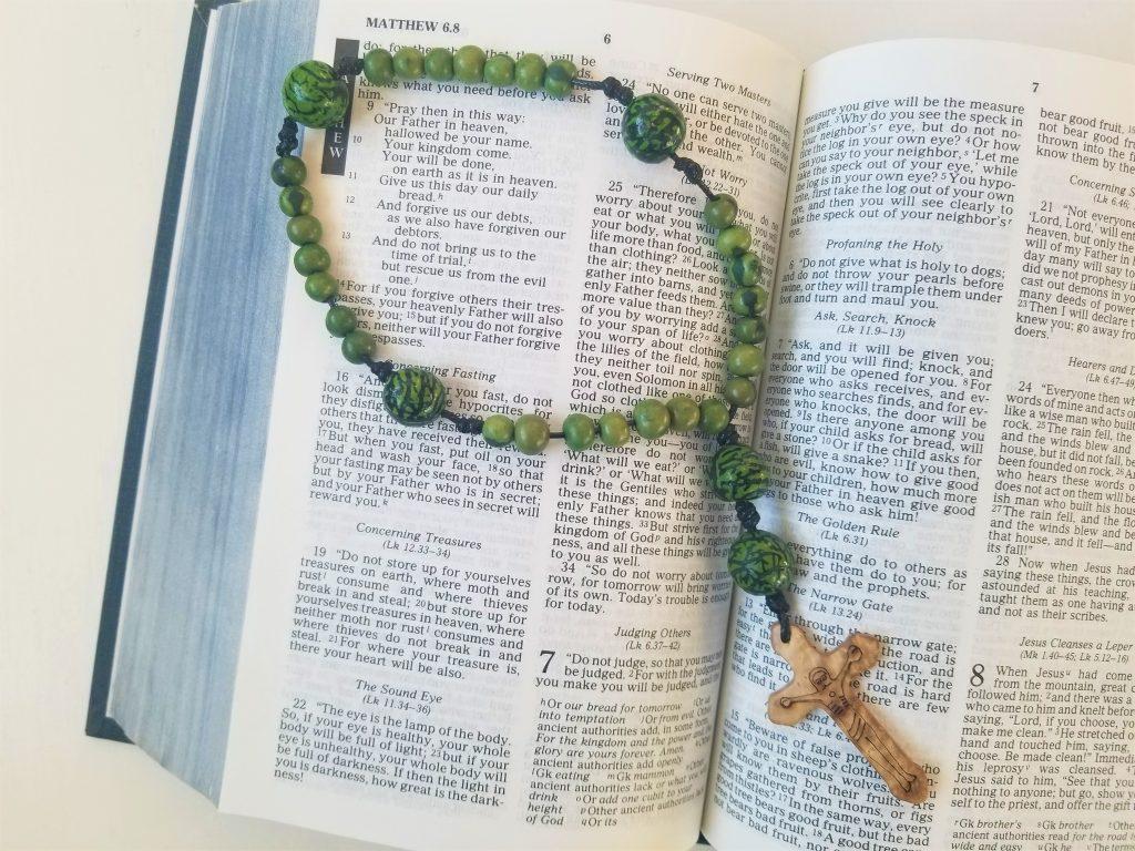 Anglican Prayer Beads on Bible