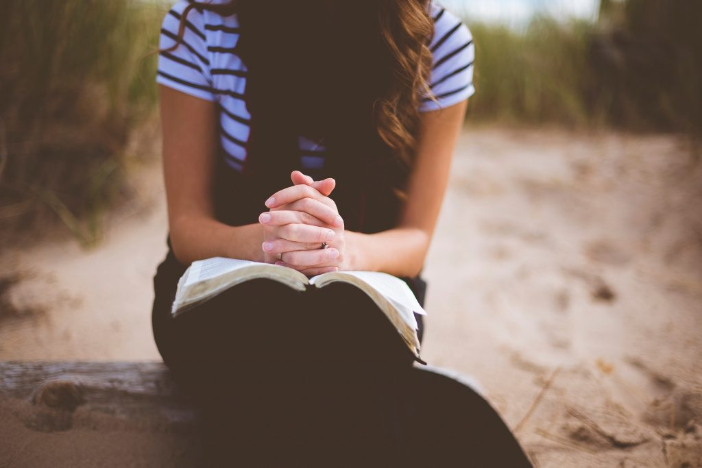 woman alone reading bible